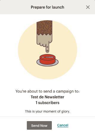 """Captura de pantalla del mensaje de """"Prepare to launch"""" en Mailchimp, con una mano a punto de presionar un botón rojo."""