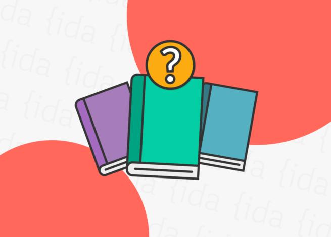 tres libros con un signo de interrogación arriba de uno de estos.
