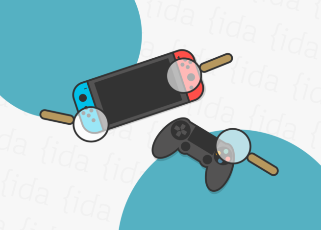 Una consola junto a un joystick que refleja a la industria de los videojuegos.