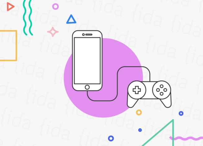 joystick conectado a un celular que hace referencia a la gamificación en estos dispositivos.